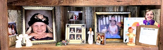 Shelf with all the Kids photos and items
