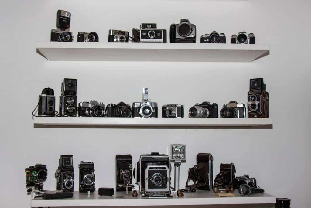 Collection of Cameras on Shelves